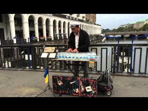 Street Artist Plays On Glass Harp - YouTube
