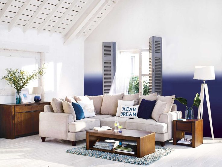 Ocean Inspired Lounge Living Room Setting Filled With Blues Against White