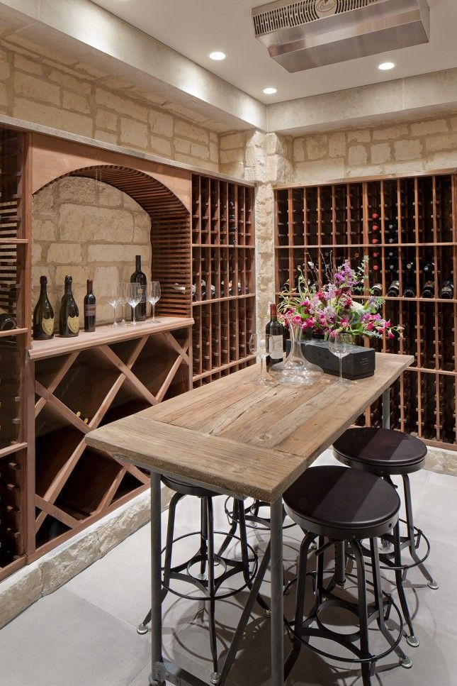 A table and stools turns this wine cellar into a tasting room, too!