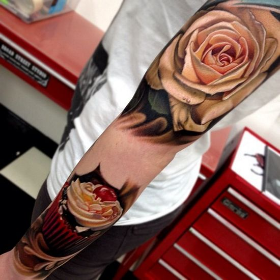 Seriously beautiful rose tattoo. Cupcakes pretty badass too.