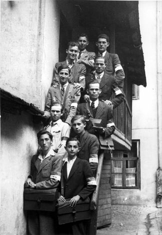 Lodz, Poland, A group photograph of ghetto mailmen.