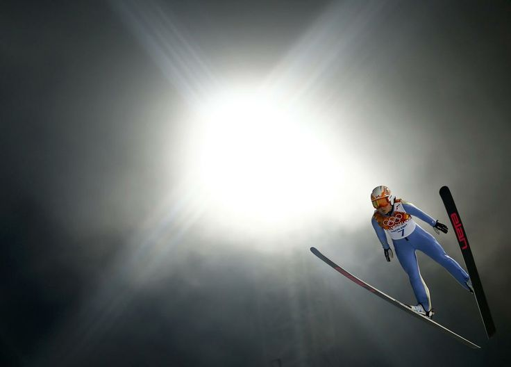 Canada's Atsuko Tanaka soars through the air during the Women's Ski Jumping Individual Normal Hill event of the Sochi Winter Olympic Games February 11, 2014