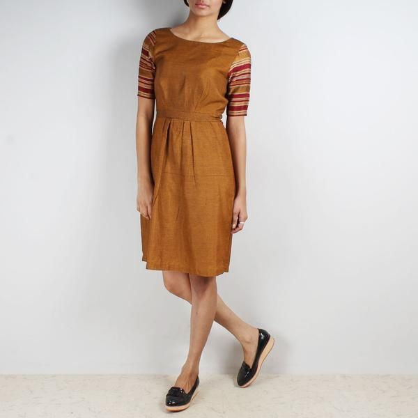 This checkered mustard knee length dress with bordered sleeves is a perfect fusion of Indian textile with western silhouettes. -www.cooliyo.com