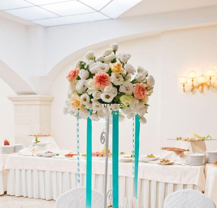 Wedding centerpiece: flowers, ribbons and swarovski necklaces by Michela & Michela www.italianweddingcompany.com