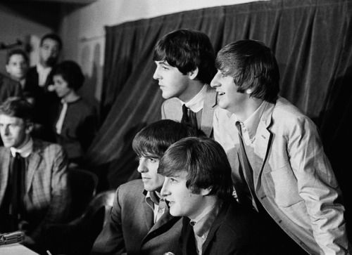 The Beatles pose for the Detroit press before taking their questions at Olympia Stadium. Sunday afternoon, September 6, 1964.