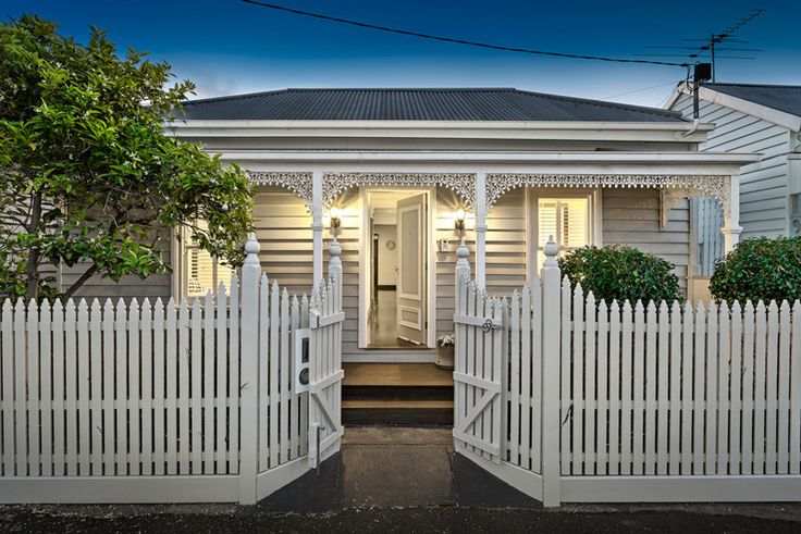 Stone and white Victorian house. 124 Stawell Street Richmond