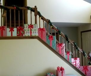 """""""Presents"""" Christmas Staircase Decorations @Rachelle Milasauskas  this would be cute in your foyer"""