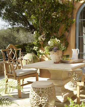 Love the chairs and stools with the stone table!