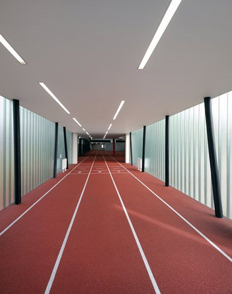 To create a full-length running track inside this refurbished gym in the Czech Republic, Prague studio QARTA Architektura added a translucent extension that projects out on stilts.