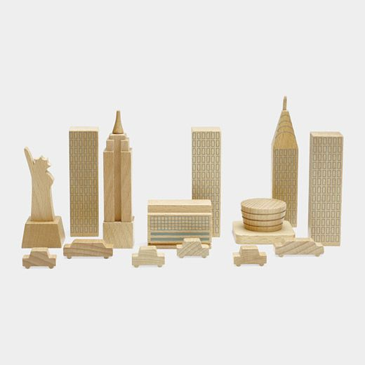 New York in A Bag: As irresistible to adults as it is to children, MUJI's New York in a Bag comes with eight wooden city structures and six wooden cars. Included are New York City icons such as MoMA's original 1939 building, the Empire State Building, the Chrysler Building, the Statue of Liberty, and the Guggenheim Museum. The wood is from sustainable forests. &17