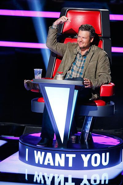 Blake Shelton sits in his chair on <I>The Voice</I> during blind auditions for season seven.