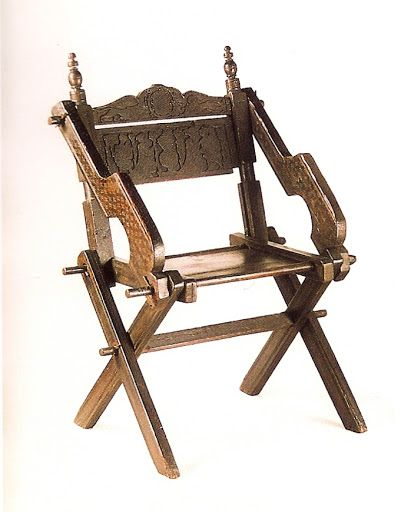 "FOLDING CHAIR WITH ARMS. Italian maker; cypress;  late 15th c; dimensions 110 cm (height); 78 cm (width); 52 cm (depth). Displayed at Bagatti-Valsecchi Museum (Milan, Lombardia, Italy); taken from ""Private Lives in Renaissance Venice"", by P. FORTINI BROWN, 2004, Yale University Press"