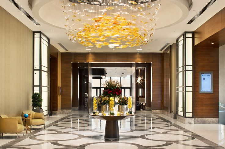 The hotel lobby of the Sheraton Grand Istanbul hotel in Turkey draws inspiration from hurricanes, with the eddy shaped lighting-fixture with leaves moving upwards. Developed with the support of Mr. Selim Cegnic of the Kreatif Mimarlik studio based in Istanbul.   #light #lighting #design #interior #lobby #room #hospitality