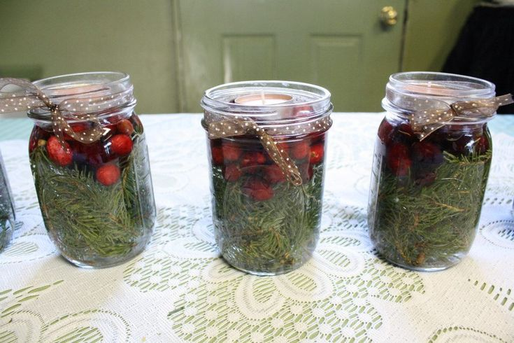 Holiday Centerpiece: Pine, water, cranberries, tea light, ribbon. #holiday #decoration