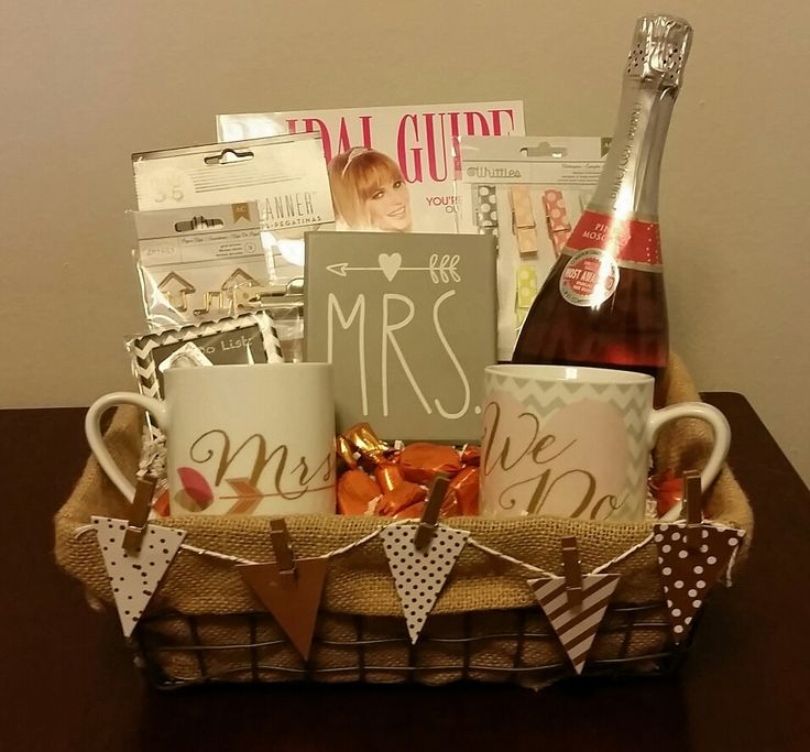 """Gift basket for newly engaged friend. I used champagne, bridal magazine, """"Mrs."""" and """"We Do"""" mugs, assorted planning items (pins, paperclips, planner stickers, etc.), """"Mrs."""" sign, mini chalkboard to do list magnet, mini notepad magnet, and chocolates."""