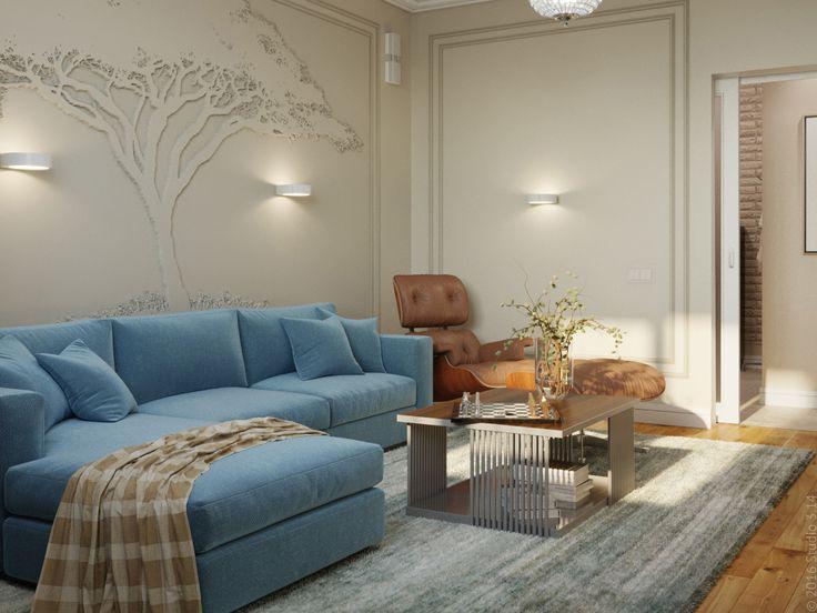Стены покрашены в деликатный цвет яичной скорлупы. Диван неброского синего цвета.