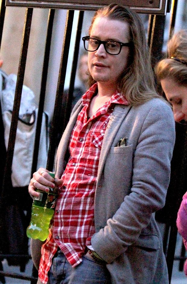 Macaulay Culkin pictured standing outside on the fire escape stairs as he films scenes for 'The Jim Gaffigan Show' in the Soho area of Downtown Manhattan, New York on March 13, 2016.