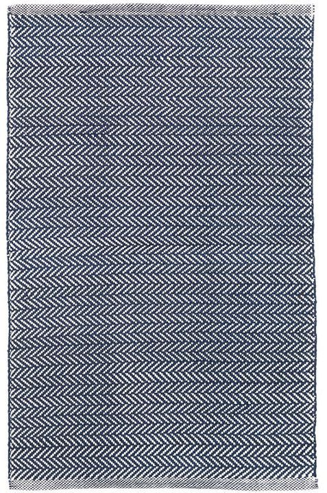 Made of durable polypropylene and featuring a classic herringbone pattern, this indigo rug is must-have for rooms throughout the home. 100% Polypropylene Regular vacuuming and the occasional gentle sh