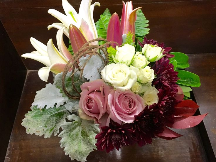 Ceramic vase with oriental lilies, roses, chrysanthemums and dust miller. By Karen. Sweet Wattle Grove Florist