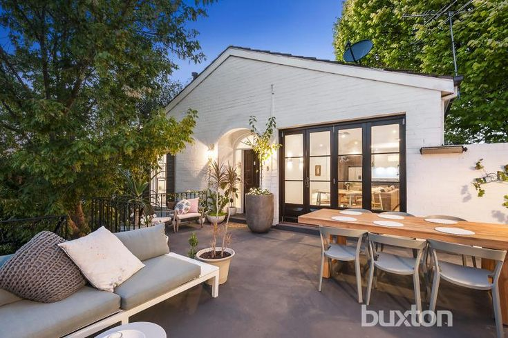 A designer sanctuary with space and style. This backyard entertainment area is beautiful!