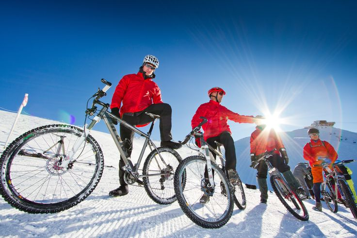 Bikers on the snow.