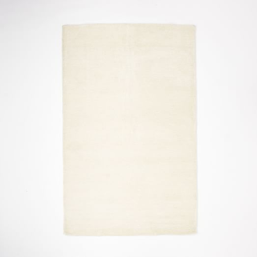 Watercolor Solid Rug - Ivory | West Elm - 6'x9' - $549 (less 20% is $439.20) - for under tufted ottoman