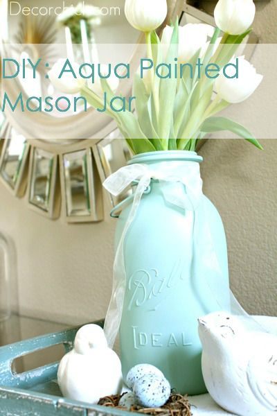 Simple mason jar spray painted with a ribbon around it and some pretty flowers inside makes the perfect Easter gift for mom!
