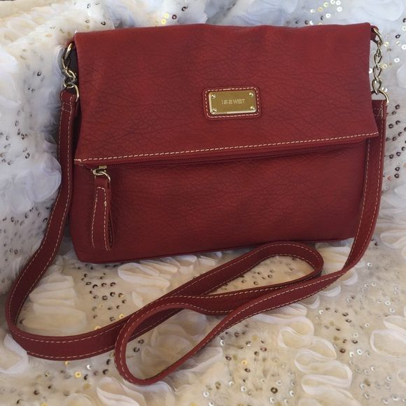 Ladies red Nine West purse Beautiful Nine West purse in the gorgeous color red. Nine West Bags Crossbody Bags