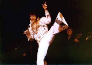 Elvis doing a High karate kick on stage!