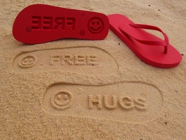 Free Hugs - sand imprint flip flops
