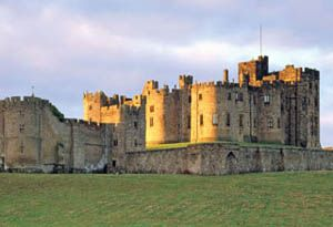 Alnwick Castle in Alnwick, Northumberland, England - UK It is a stately home and the residence of the Duke of Northumberland, built following the Norman conquest, and renovated and remodelled a number of times. It is a Grade I listed building with spectacular gardens
