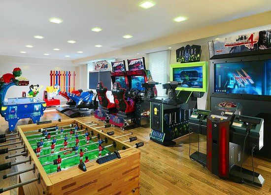 kids game room video game room for the kids brown wooden floor design large kids room design. Black Bedroom Furniture Sets. Home Design Ideas