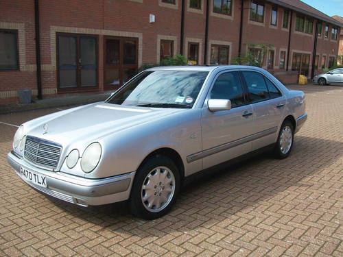 Mercedes e280, 1998.  Good car.  Good acceleration.  Amazing turning radius.  Boring to look at though.