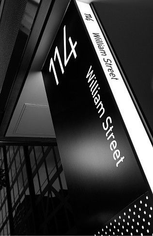Providing a more defined presence for the building at street level, the main location sign is a three metre high lightbox wrapped with perforated anodised aluminium panels.