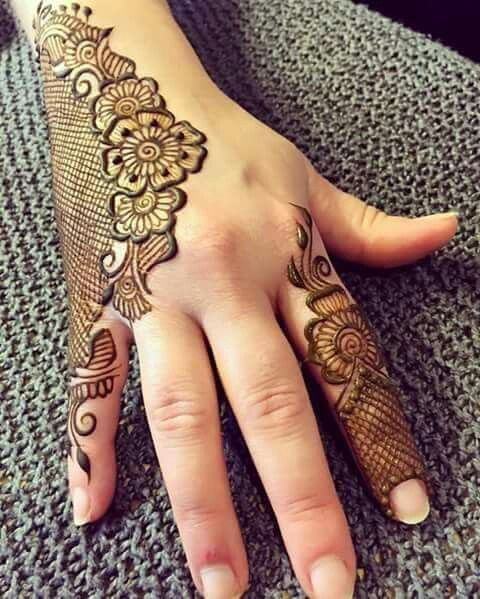 Love the use of negative space with this modern mehndi design.  Great template for indian wedding guests.