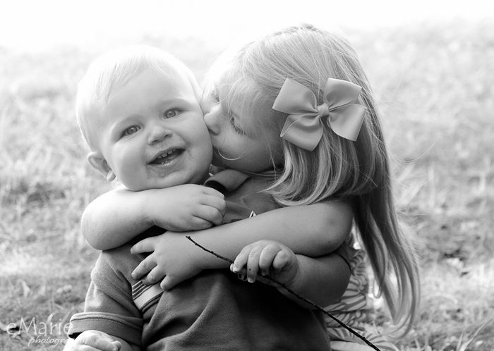sister kissing brother on the cheek - eMarie Photography