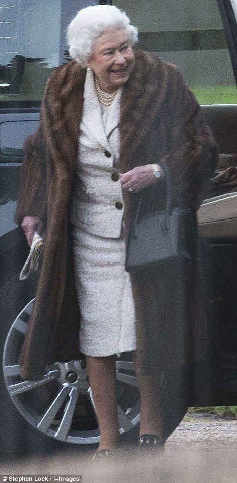 Elegant: The Queen wrapped up in a sophisticated fur coat as she arrived at St Mary Magdalene Church for the traditional service