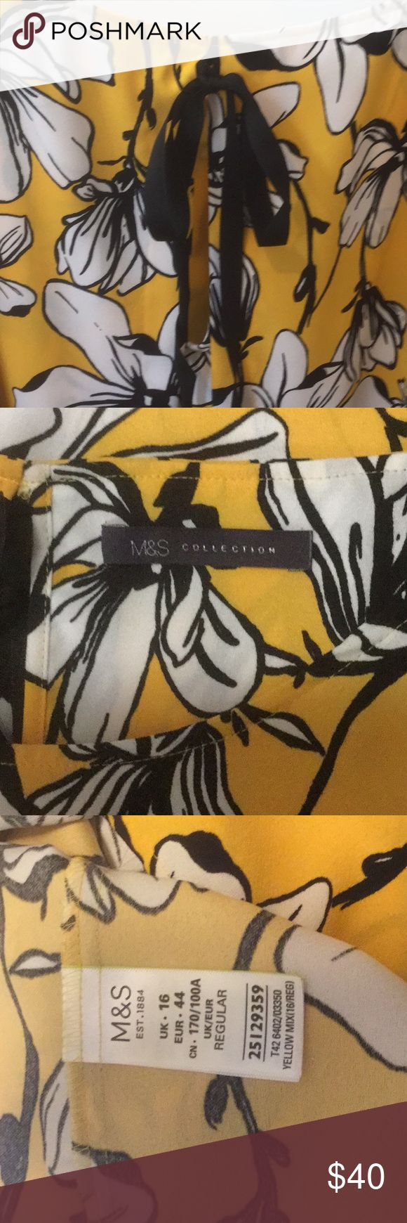 Marks and Spencer Dress Floral Print Double Layered Shift Dress Cotton Rich Flared   Yellow dress with white flowers and black boarders.  Cute bow in back.  Very comfy dress wore one time. I'm 5'5 it hit right above my knee. Marks & Spencer Dresses Midi