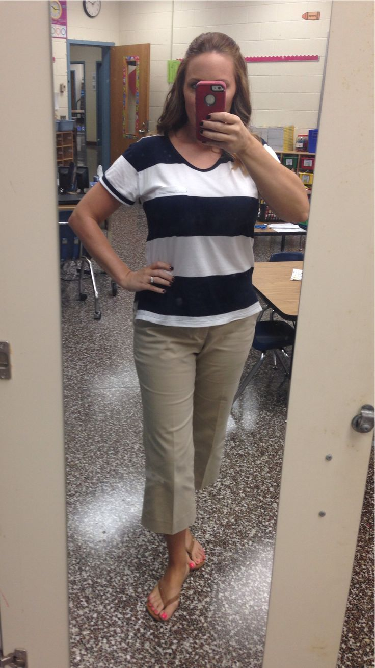 Navy and white stripe shirt, khaki capris, camel flip flops.