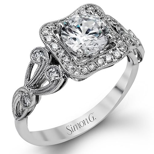 Passion Collection - This romantically vintage 18K white gold ring showcases a stunning halo and .27ctw of white diamonds. - TR549