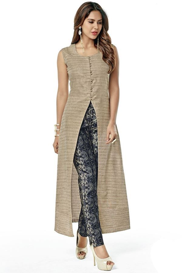 Adorn this edgy suit featuring a beige colored cotton kurta with a simple round neck and fabric buttons at the front ending in a front slit starting at the waist. Shoulders are accentuated with self fabric pin tucks for design! This suit is accompanied with contrasting black printed straight cut pants in silk.