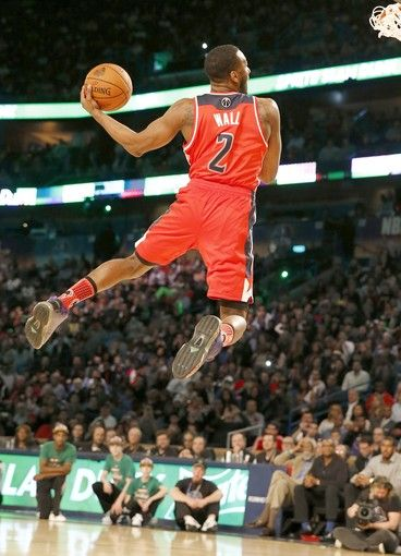 An unsettled air in John Wall's slam dunk contest victory The Washington Wizards point guard shines, but the same cannot be said of the competition's new format. Washington Wizards point guard John Wall competes in the NBA All-Star slam dunk contest in New Orleans on Saturday night.