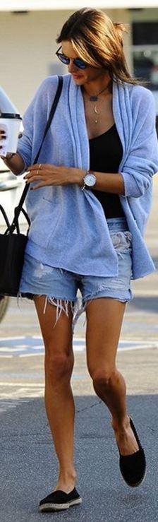 Who made  Alessandra Ambrosio's black handbag, blue cut off shorts, blue cardigan sweater, and sunglasses?