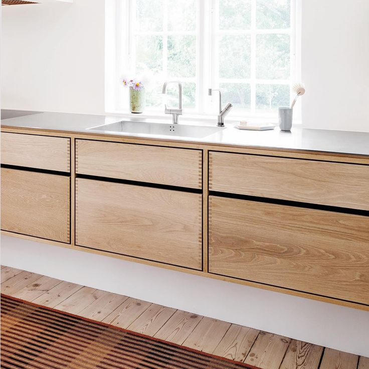 "This design is called ""Model Cabinet"" - a kitchen furniture made in Danish oak wood which we have treated with a natural soap. On top floats a solid stainless steel worktop. #madetomeasure #kitchenporn #cabinetmaking #danishdesign #nordicliving #oakkitchen #stainlesssteelworktop #drawers #floatingkitchen #kitchenfurniture #ourworkwilloutliveyou"