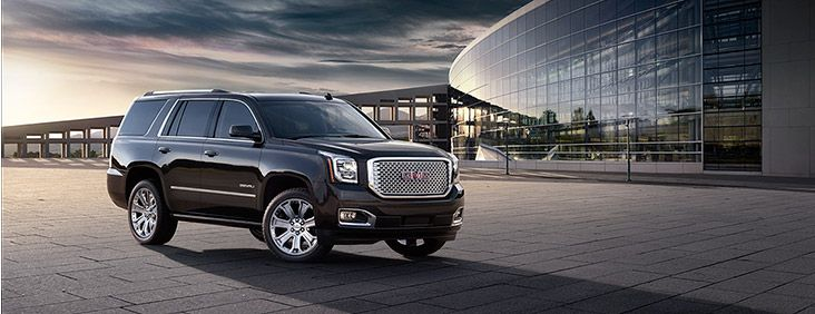2015 Yukon Denali full size luxury SUV with polished chrome wheels and grill.