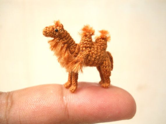 This is a tiny crocheted two-humped camel. He comes in standing position and is crocheted by embroidery threads, his eyes are sewn black cored plastics and