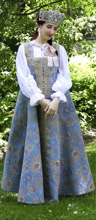 Russian traditional costume. Festive attire of a young girl from northern provinces; late 19th century; modern replica.