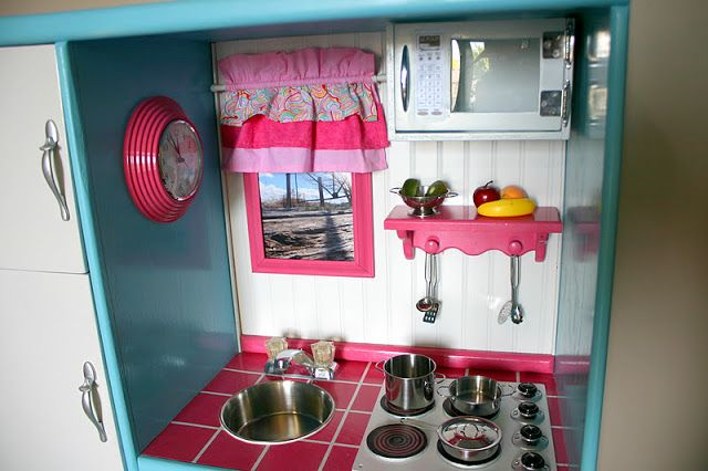 Doubletake Decor: Play Kitchen Made From An Old Entertainment Center Pictures of burners. Place to hang utensils