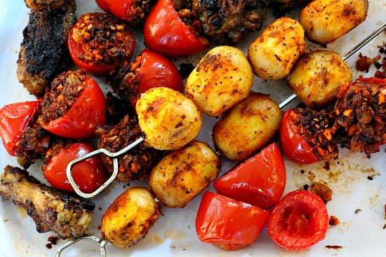 Grilled chicken wings and grilled BBQ potatoes for football food tailgating.