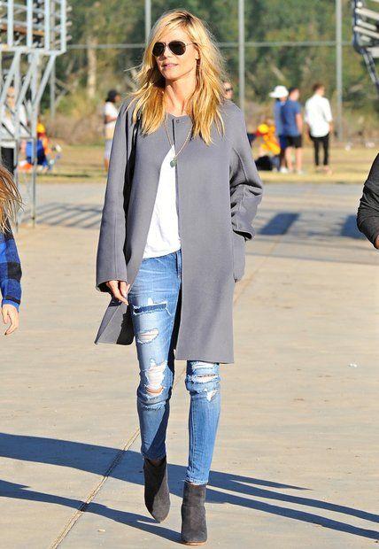 Fashion-Looks: Auf dem Fußballplatz mit ihren Kids ist Heidi Klum die lässige Mama. Das Topmodel macht in ihren bequemen Jeans, den grauen Boots und dem grauen Mantel von Iris von Arnim eine tolle Figur.